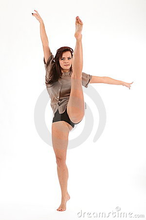 High Kick Dance Move By Beautiful Young Woman Stock Photos