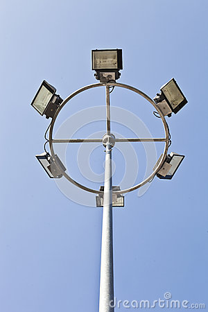 High mask light pole on blue sky background