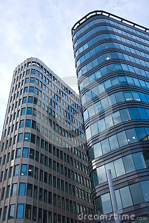 High modern office buildings in a city over blue s