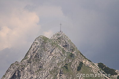 High mountain with cross Stock Photo