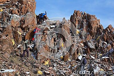 High mountains treking group climbing