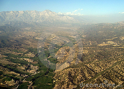 High Peaks Rise Above the Haze Near Pakistan