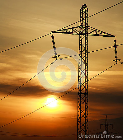 High power electric line towers at dramatic sunset