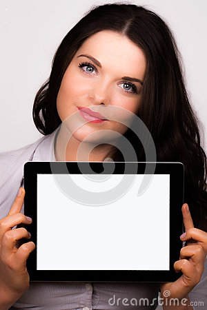Beautiful young female using an ipad tablet device