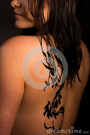 Young sexy women with a dragon tattoo on her back