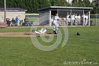 High school baseball player eating dirt. Editorial Stock Photo