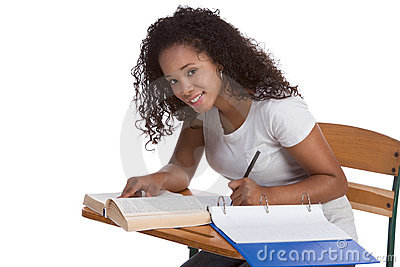 High school schoolgirl student by desk studying