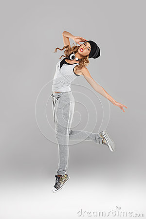 High-spirirted young woman dancing