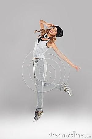 High-spirirted young woman dancing