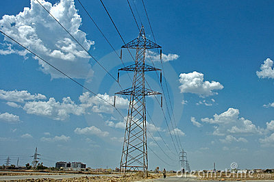 High Voltage Electric Power Cable Towers blue sky
