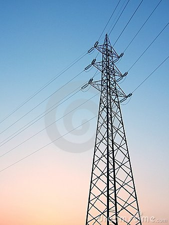 High voltage electric tower and wires - sunset