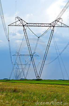 High-voltage line of electricity on field