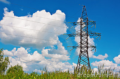 High voltage lines and blue cloudy sky