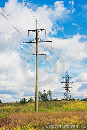 High voltage lines and cloudy sky