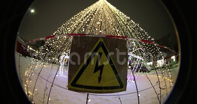 High voltage plate gently Festive Christmas illuminations at night in the park. optical effect Circular fisheye.  stock video