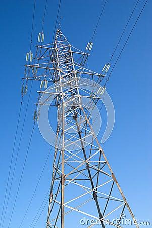 High-voltage power line metal prop  over blue sky