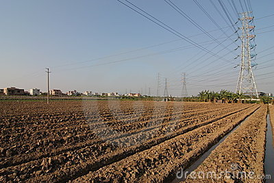 High-voltage tower with farmland