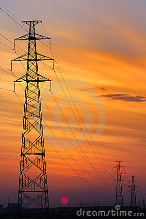 High-voltage wire tower, sunset