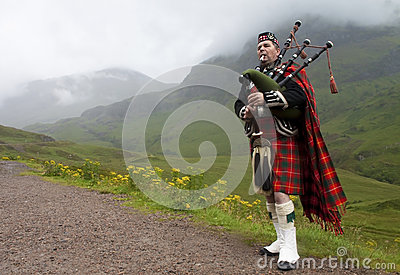 Highland bagpiper, scotland Editorial Image