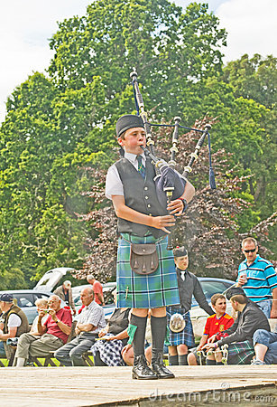 Highland piper at Strathpeffer. Editorial Photography