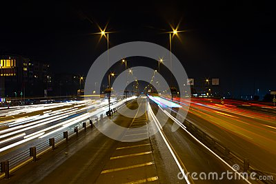 Highway through city at night