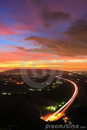 Highway in the night with amazing sunset