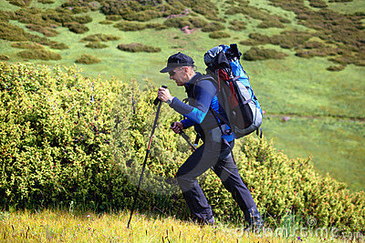 Hiker with backpack in mountains