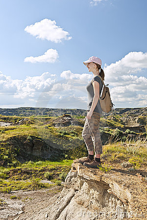 Hiker in badlands of Alberta, Canada