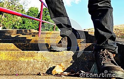 Hiker boots climbing high steps