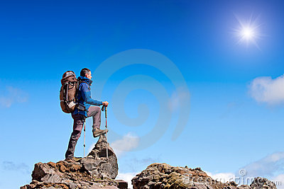Hiker celebrates on the summit