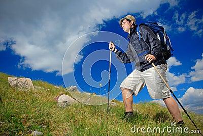 Hiker climbing a peak