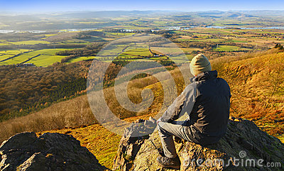 Hiker in countryside landscape