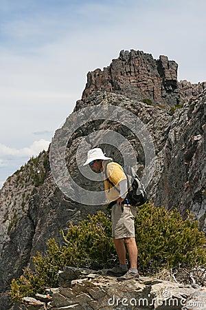 Hiker on edge of mountain