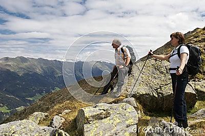 Hiker enjoying stunning view of the Alps
