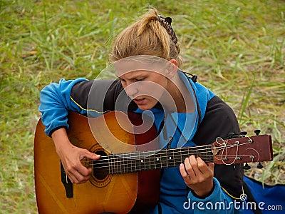 Hiker girl playing guitar