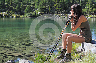Hiker girl seated on a stone