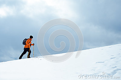 Hiker going up on a slope