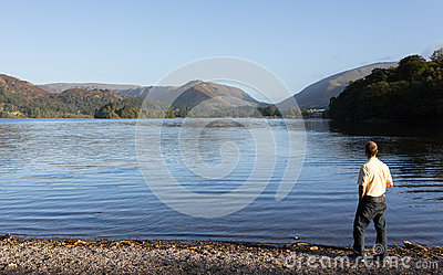 Hiker at Grasmere at dawn in Lake District