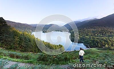 Hiker at Grasmere at dawn in Lake District