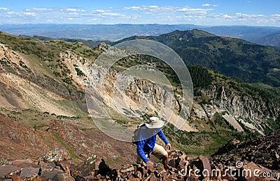 Hiker high on mountain ridge