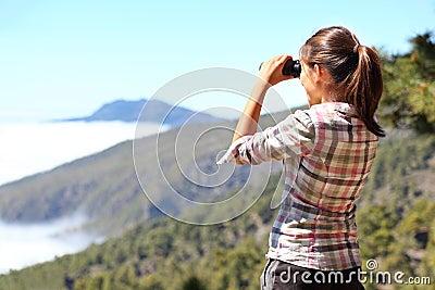 Hiker looking in binoculars