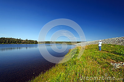 Hiker looking at a coastal lagoon