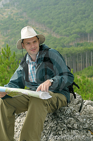 Hiker looking at a map while out trekking