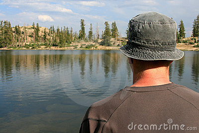 Hiker looking out over lake