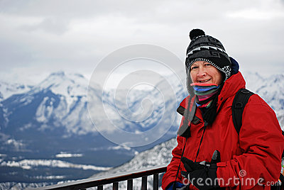 Hiker looking over Canadian snowy mountains