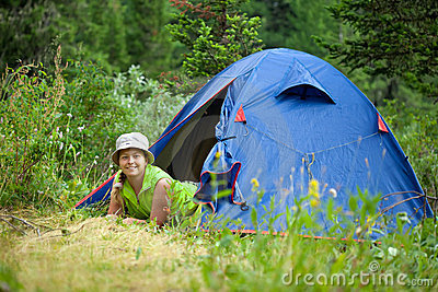 Hiker lying in camp tent