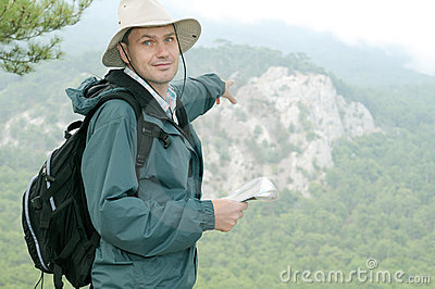 Hiker with map while out trekking