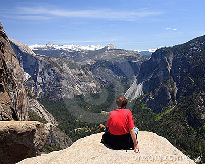 Hiker overlooking Yosemite view
