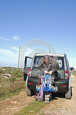 Hiker preparing the knapsack