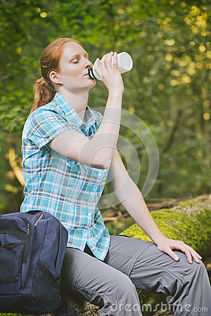 Hiker Resting And Drinking Water Stock Photo